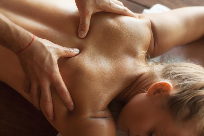Woman undergoing a relaxing back massage.